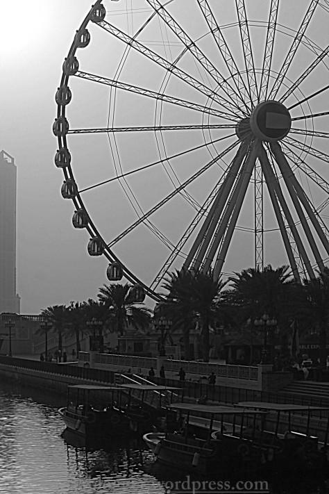 The canal, abbras, ferry wheel : Qanat al-Qasba